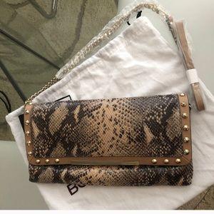 Nwt Bcbg MaxAzria genuine leather clutch.